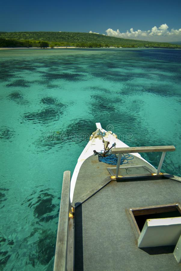 Dive Boat at Menjangan island, Bali, Over a Coral Reef. Menjangan Island is a destination for snorkelers and scuba diver for it beautiful coral reef. Located in royalty free stock photo