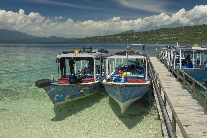 Dive Boats at Menjangan Island. Menjangan Island is a small island, located 5 miles to the north-west of Bali island, is known for it's healthy colorful reef and stock image
