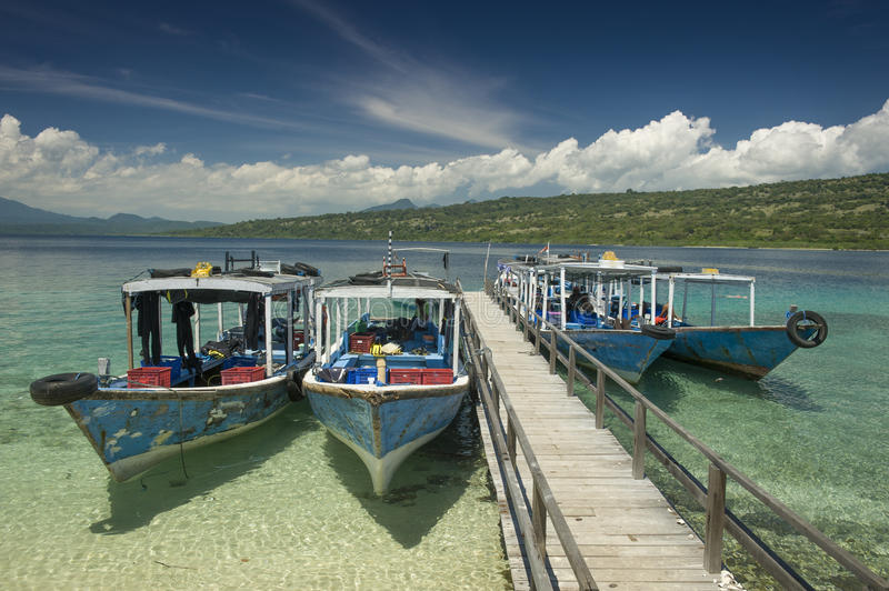 Dive Boats at Menjangan Island. Menjangan Island is a small island, located 5 miles to the north-west of Bali island, is known for it's healthy colorful reef and stock photos