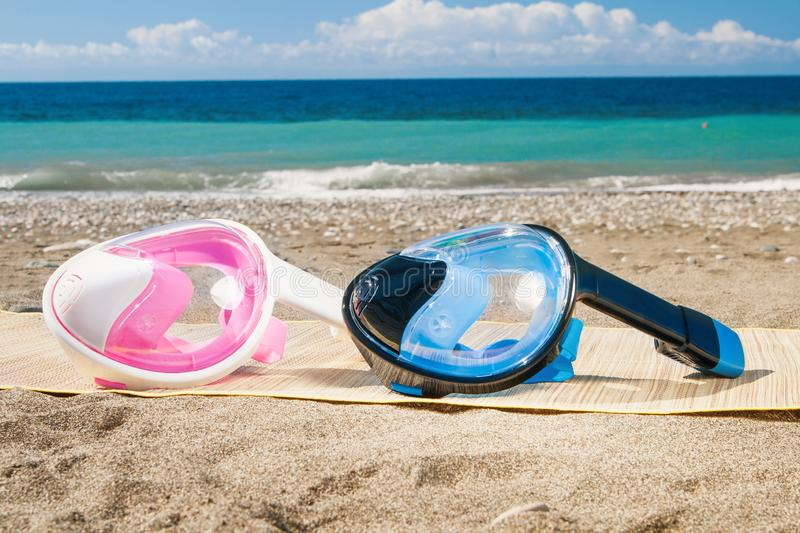 Dive mask and snorkel, snorkelling on sand. Dive mask and snorkel, snorkelling on sand stock photography