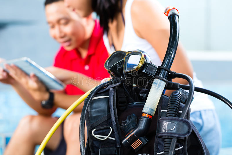 Dive master and student in Asian diving school stock photos