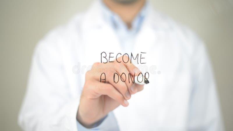 Diventa un donatore, scrittura di medico sullo schermo trasparente immagini stock libere da diritti