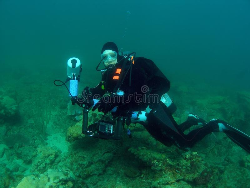 Diver With Camera royalty free stock photography