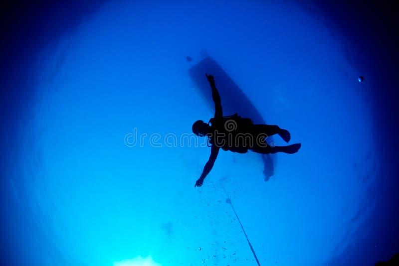 Diver descending stock photo