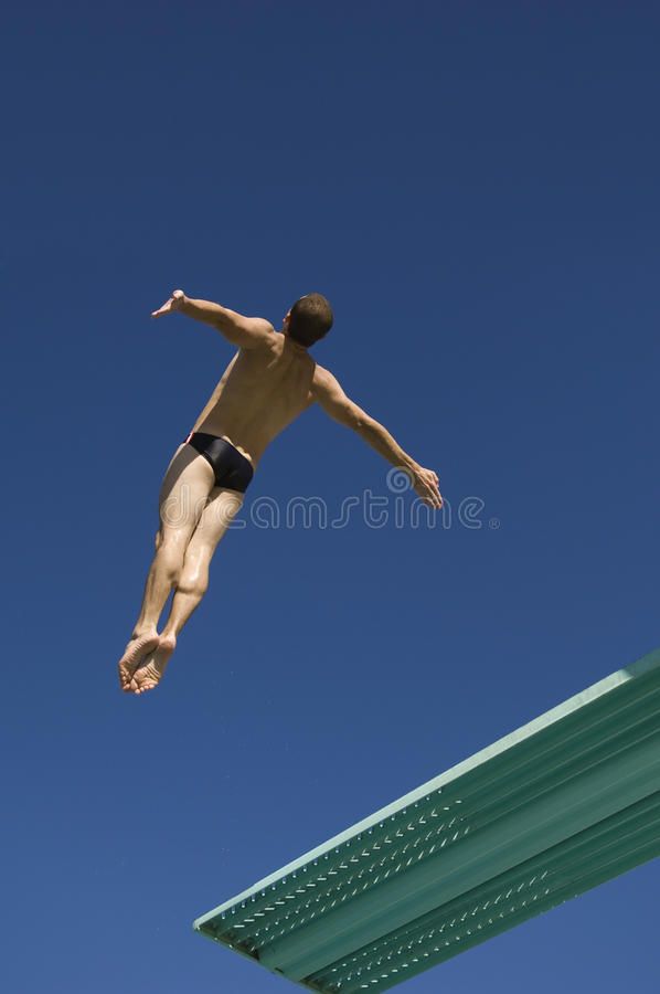 Diver Diving From Springboard In Midair