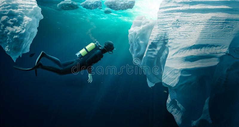 Diver ecploring the pack ice stock photography