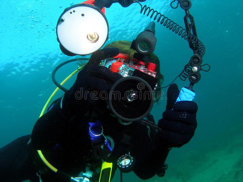 Diver and her camera royalty free stock photography