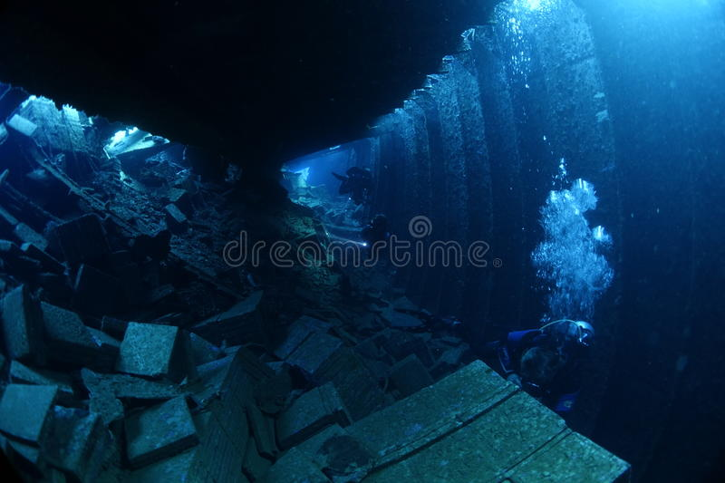Diver inside the shipwreck Chrisoula K. Divers penetrating the shipwreck of the Chrisoula K in the Red Sea, Egypt royalty free stock photography