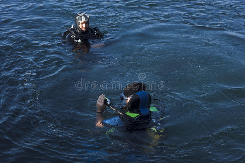Diver-instructor checks stock images