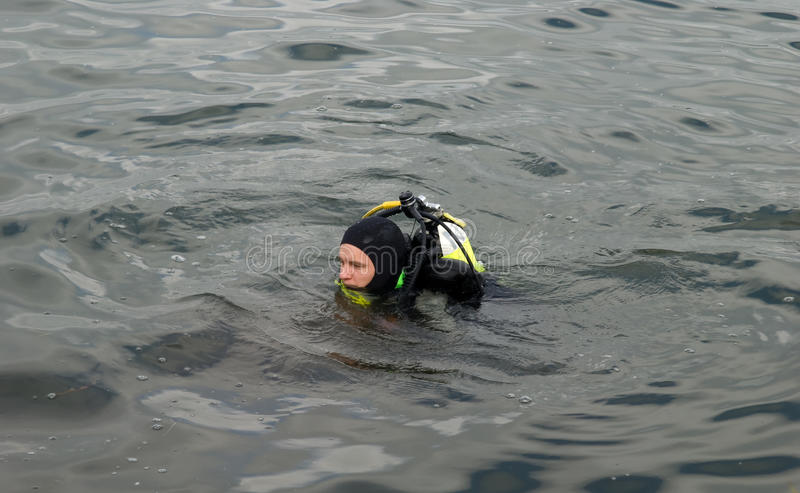 Diver on lake stock photography