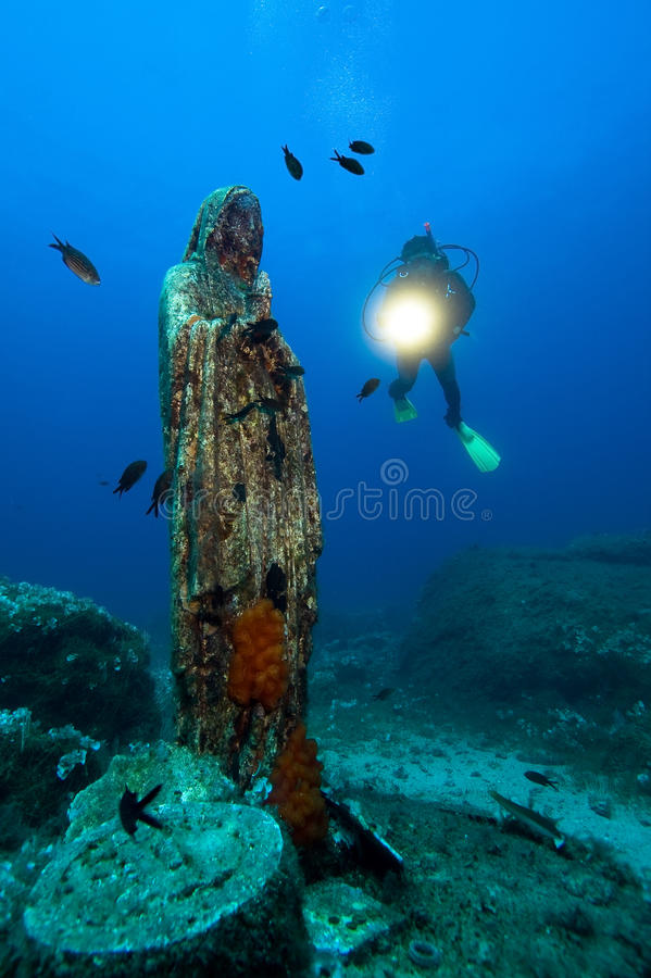 Diver and madonna royalty free stock photography