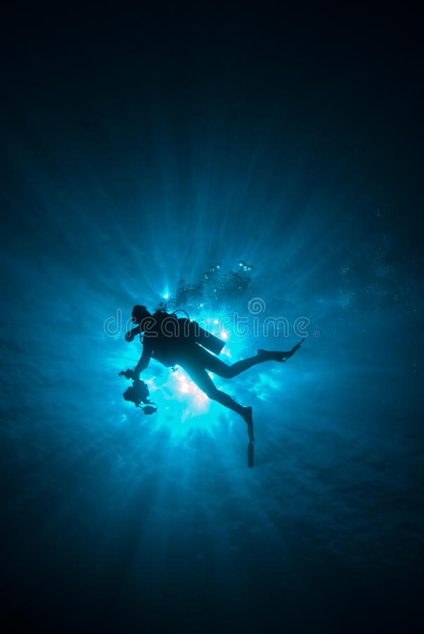 Diver with sunrays royalty free stock photos