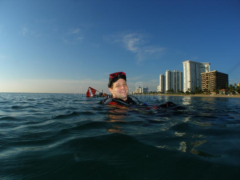 Download Diver At Surface With Dive Flag Stock Photo - Image: 21965306
