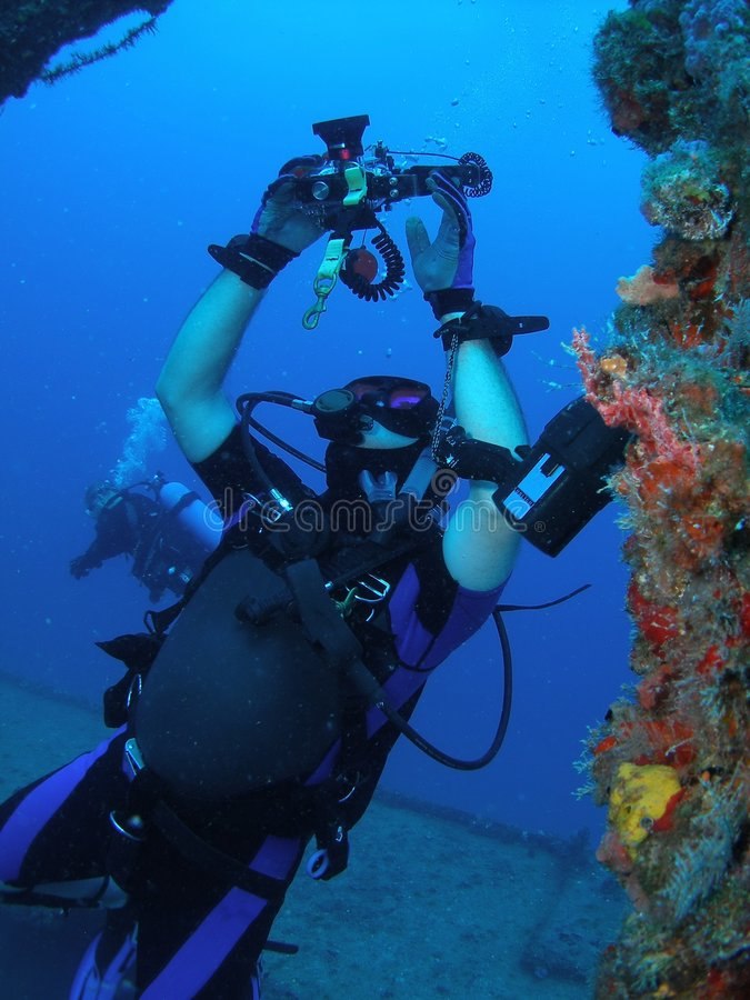 Diver taking pictures royalty free stock images