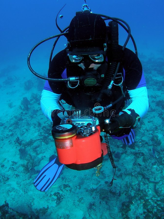 Diver with underwater Camera stock photo