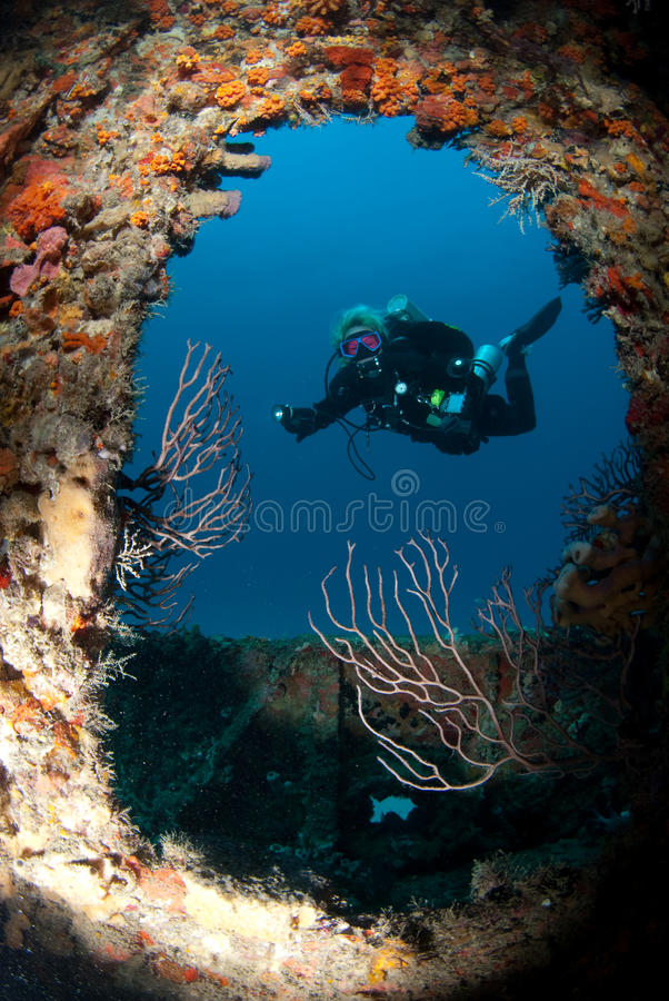 Diver on wreck royalty free stock photo