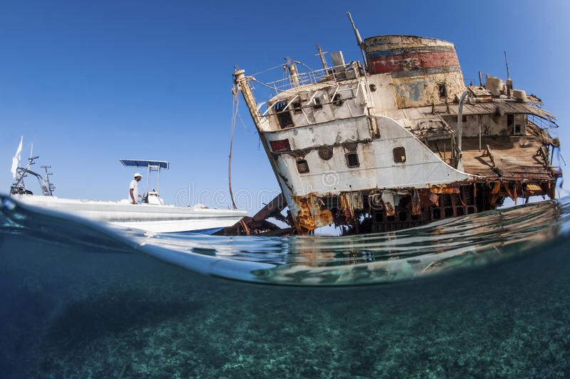 Diver with wreck. Wreck in the Red Sea, tiran island royalty free stock photo