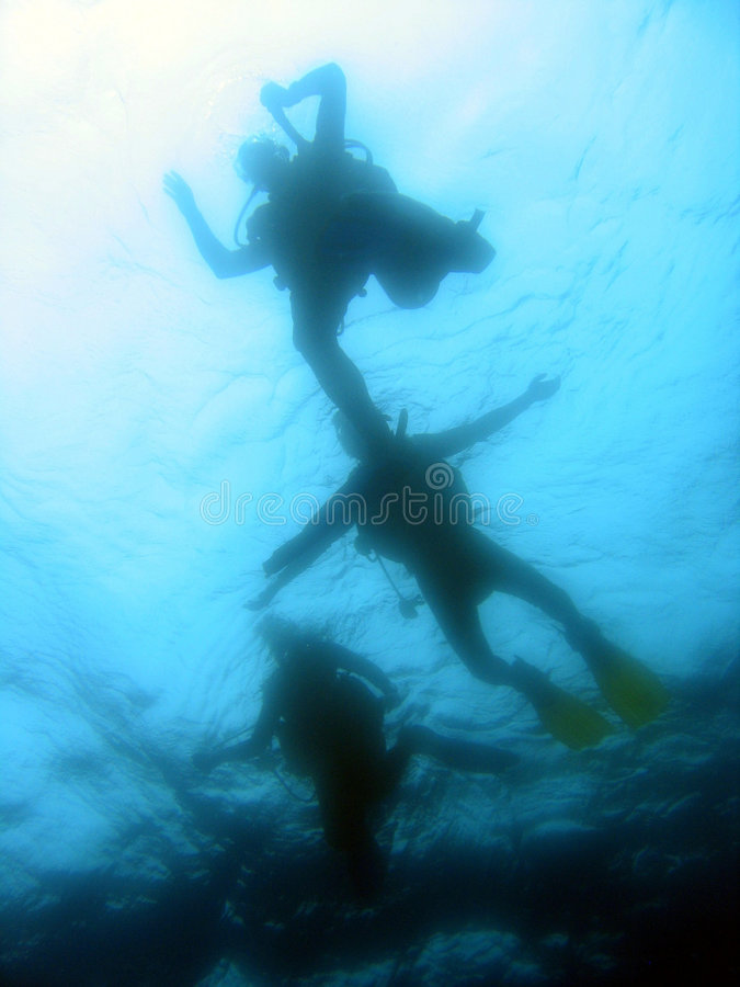 Divers ascending royalty free stock images