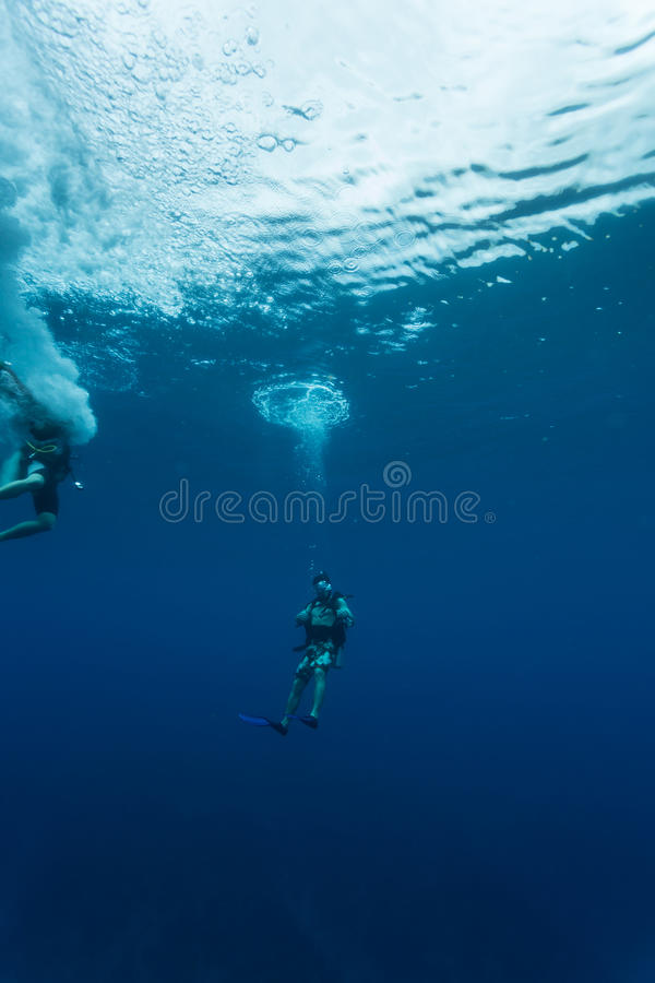 Divers descend into Blue Hole in Caribbean Sea Bel stock images