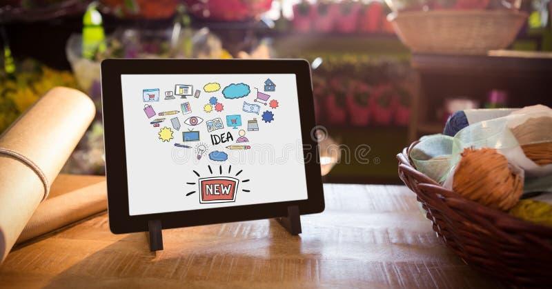Divers icônes et texte en comprimé numérique par le panier et papier sur la table illustration libre de droits