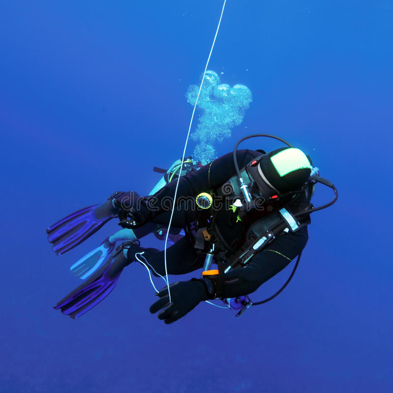 Divers at 5-minute Stop stock photography