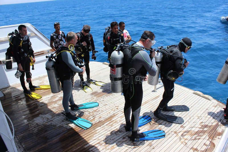 Divers waiting to jump royalty free stock photo