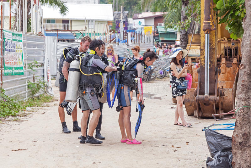 Divers walking back from diving trip. stock photos