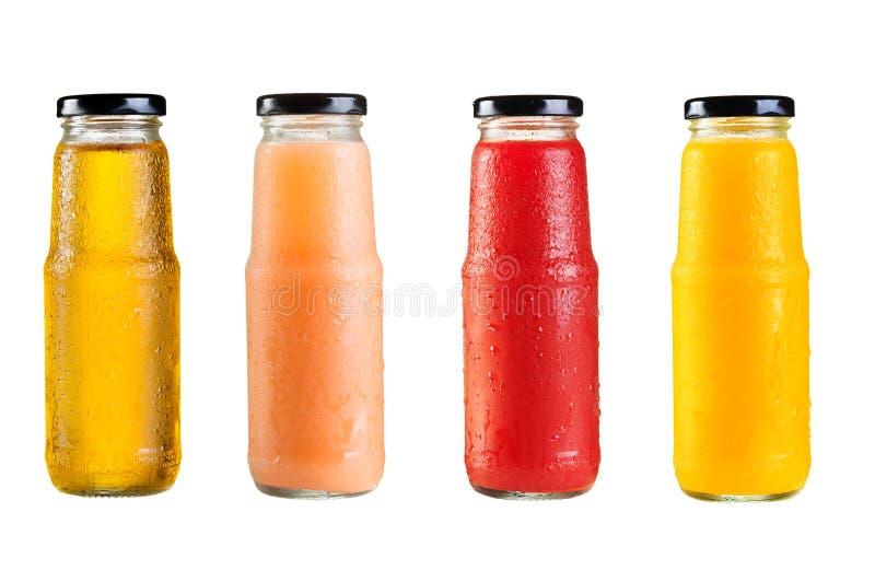 Diversas botellas de jugo foto de archivo