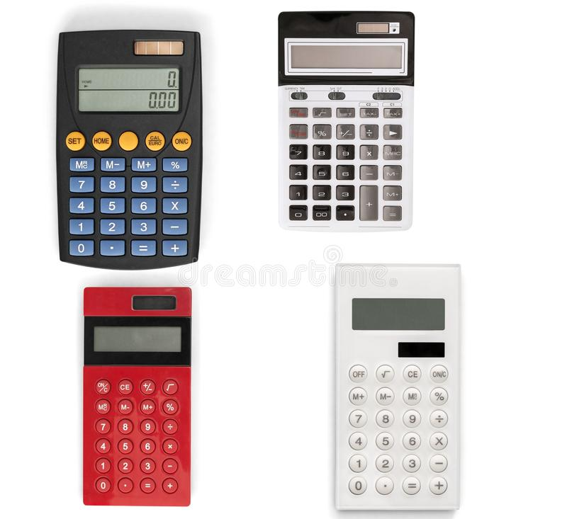 Diversas calculadoras modernas aisladas en blanco fotografía de archivo