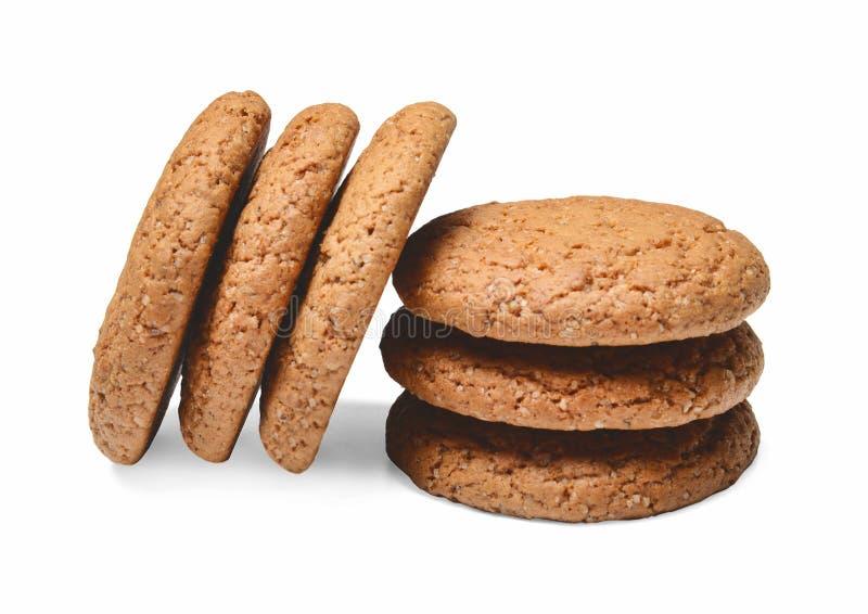 Diversas partes de cookies de farinha de aveia hilted sobre se Fundo isolado branco Quartos pr?ximos imagens de stock royalty free