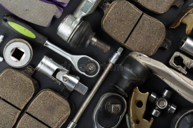 Diversas piezas y herramientas del coche fotos de archivo