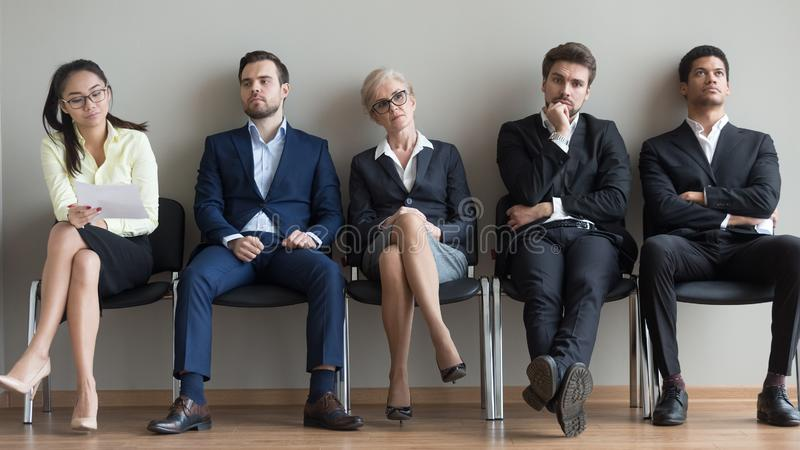 Diverse applicants waiting for their turn preparing for job interview stock image
