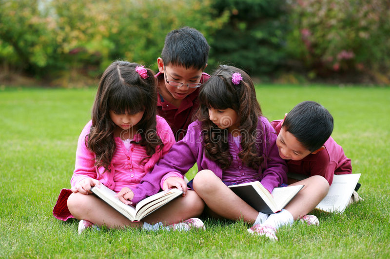 Diverse boys and girls reading royalty free stock photo