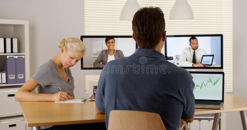 Diverse business colleagues working together via the internet royalty free stock photography