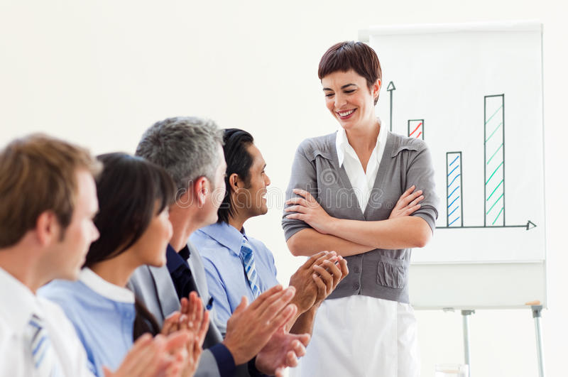 A diverse business group applauding a presentation stock photos