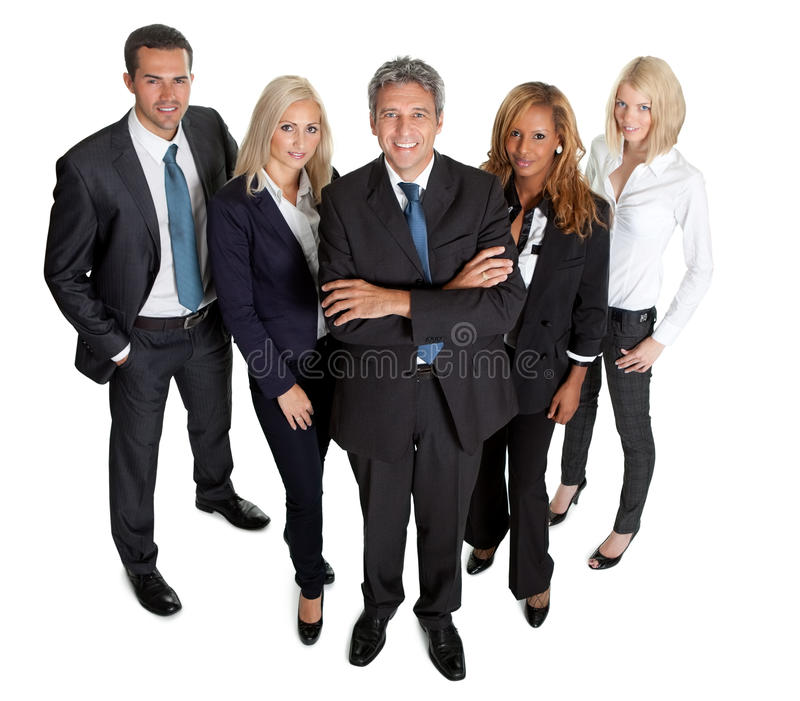 Diverse business group standing proudly on white stock image