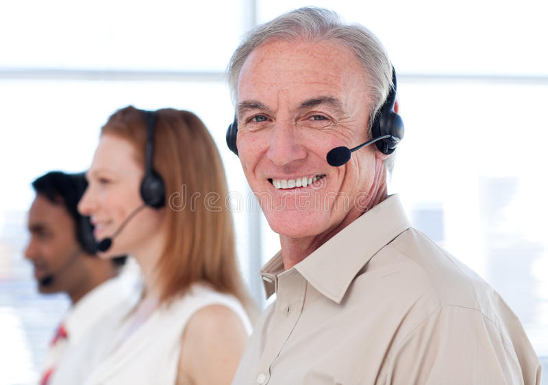 A diverse business group working in a call center stock photography