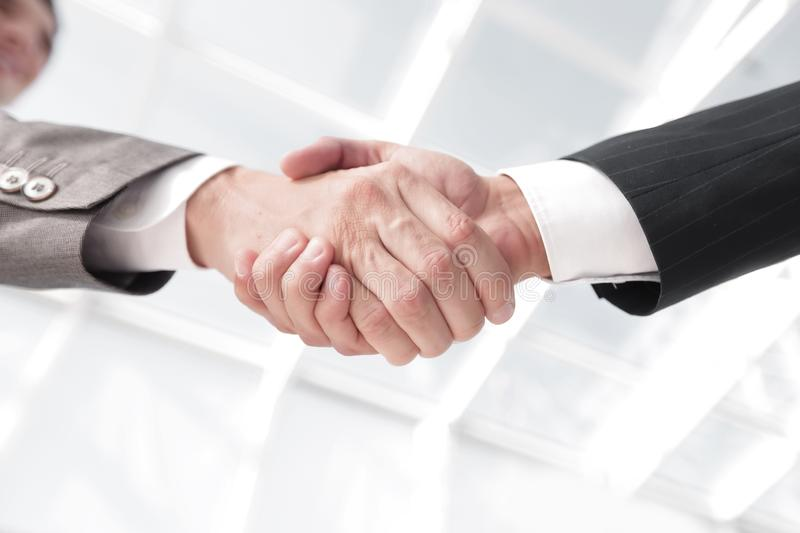 Diverse business male shaking hands. stock photography