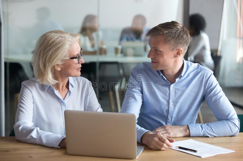 Diverse business partners discuss cooperation at meeting royalty free stock images