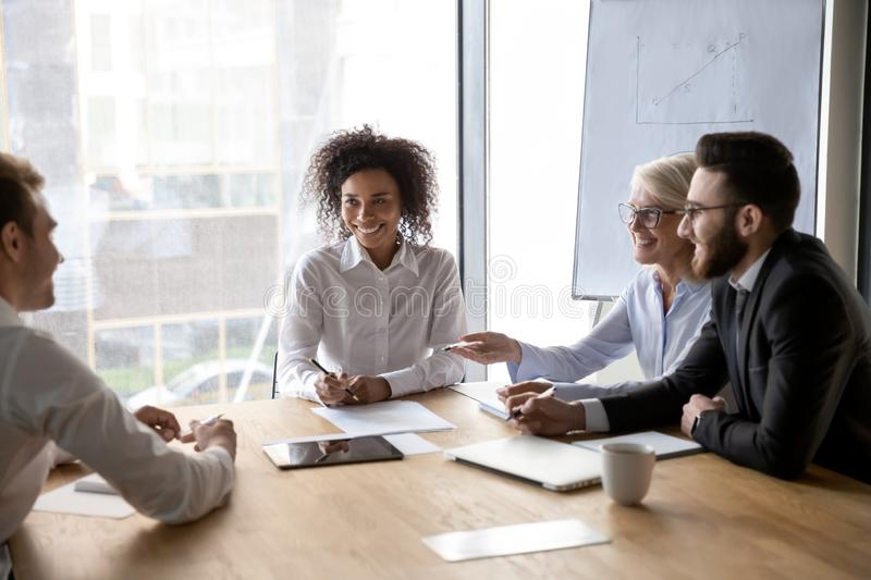 Diverse business partners discussing ideas at group negotiations royalty free stock photos
