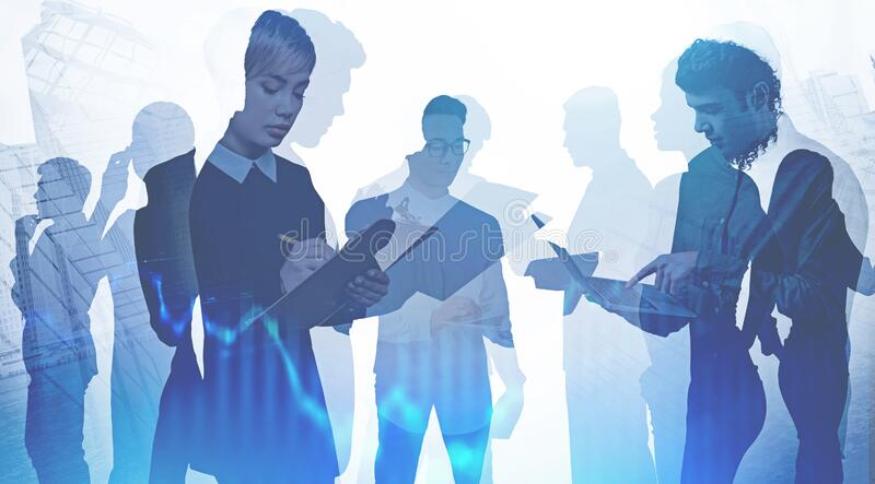 Diverse business people in city. Digital chart. Team of diverse business people working together with gadgets and papers in city with double exposure of blurry royalty free stock photo