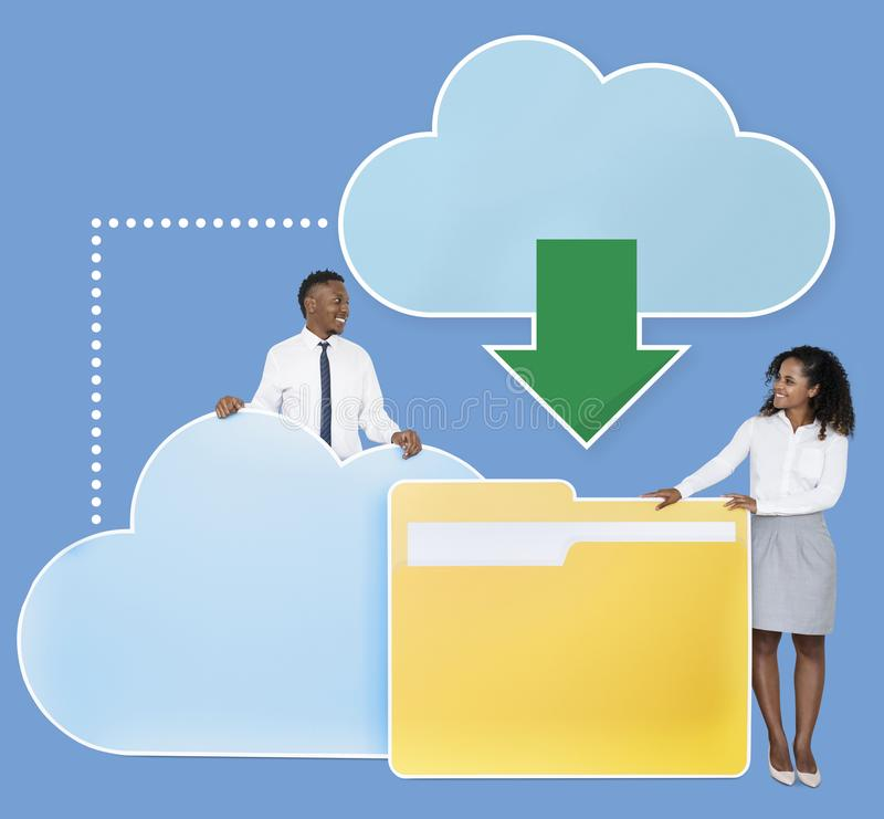 Diverse business people downloading data from a cloud icons royalty free stock photos