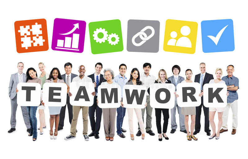 Diverse Business People Holding Word Teamwork stock photography
