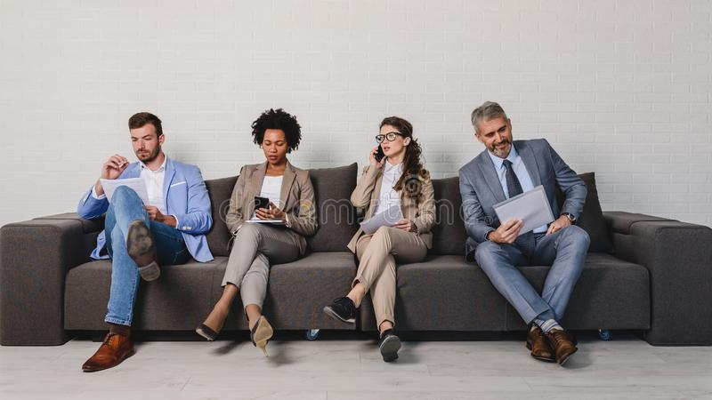 Diverse business people waiting for an interview stock photos