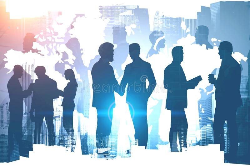 Diverse business people working in global world. Diverse business people working together over cityscape background with double exposure of world map royalty free stock photo