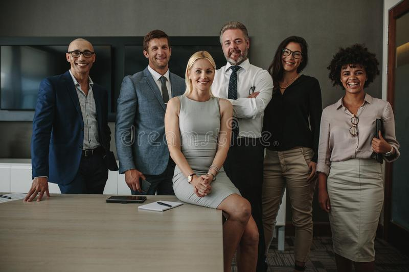 Diverse business professionals together in meeting room stock photos