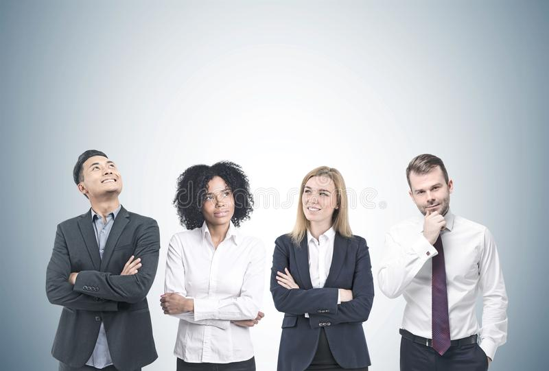Diverse business team brainstorming, gray royalty free stock image