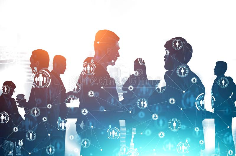 Diverse business team in city, social network. Silhouettes of business people communicating in modern city with double exposure of HUD social network interface stock photography