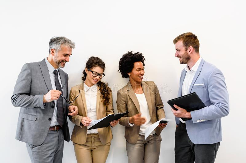 Cheerful diverse business team discussing work royalty free stock image