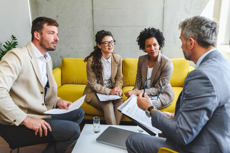 Diverse business team discussing work in their office royalty free stock image